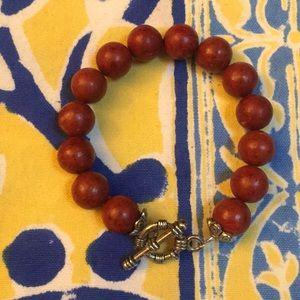 Russet beaded bracelet with silver clasp